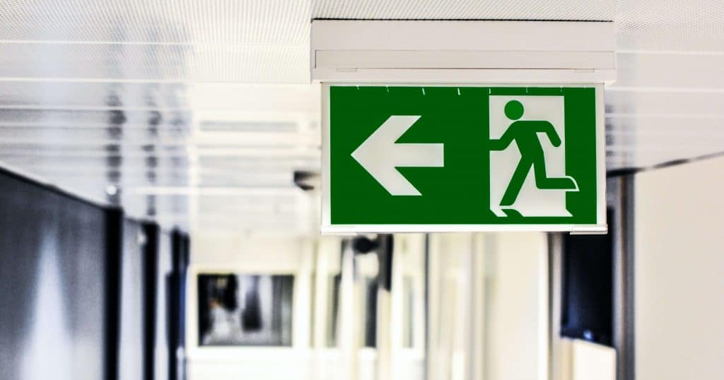 NPCrowd - Nonprofit Turnover is a problem. Photograph of exit sign.